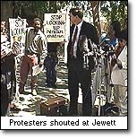 Protest against                                     Harold Hal Jewett prosecuting a 6                                     year old for murder